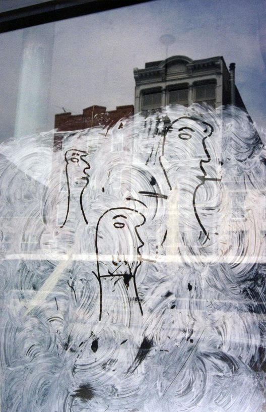 Saul Leiter  Graffiti Heads 1950